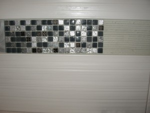decorative mosaic tile being installed