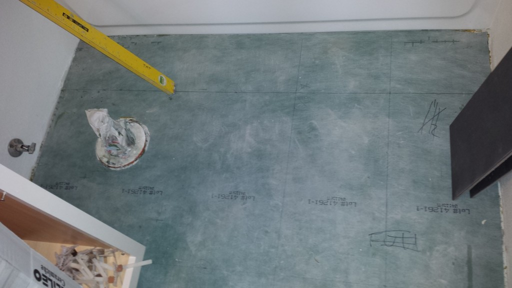 Bathroom floor with tile layout lines drawn