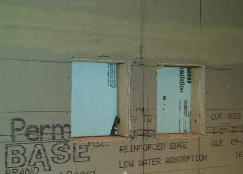 2 inch foam in back of recessed niche in an exterior wall of a shower