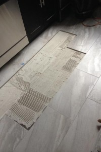 tile popped loose