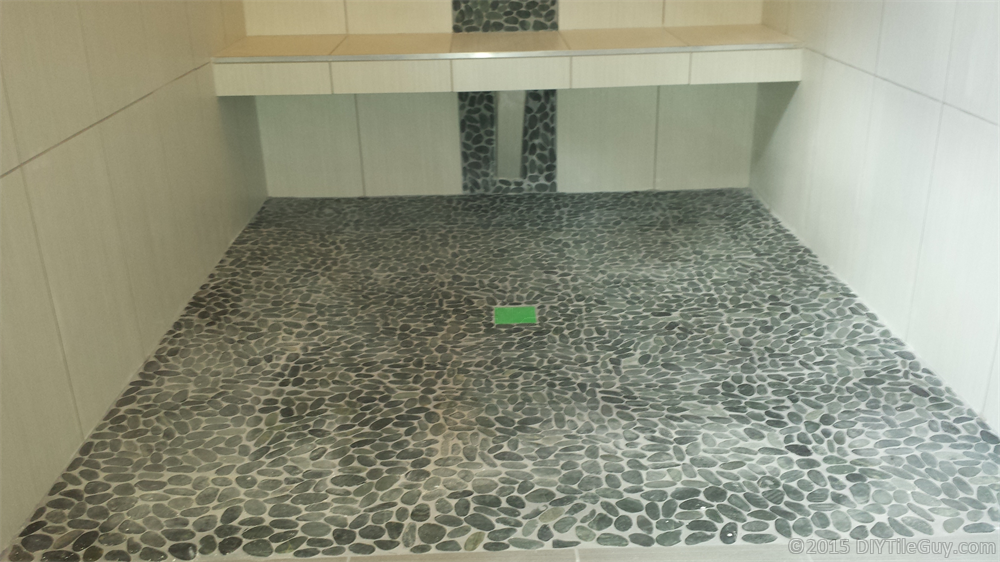 River rock flooring installation gurus floor for Installing river rock tile