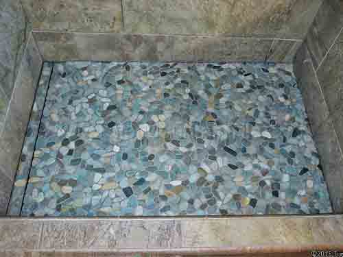 pebble tile shower floor linear drain