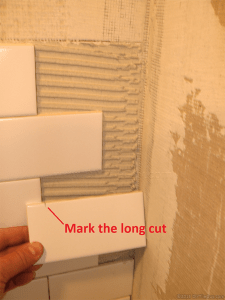 Mark cut ceramic subway tile