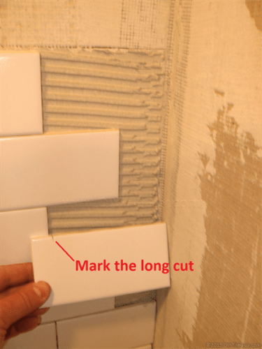 Mark cut ceramic subway tile