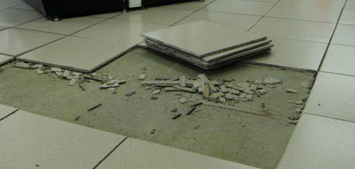 Loose floor tiles missing