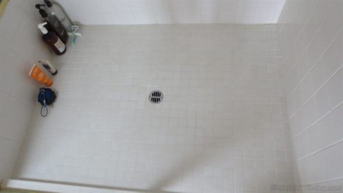 shampoo bottles on floor
