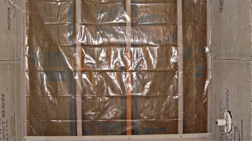 plastic vapor barrier behind cement board